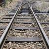 TIR cazut de pe un podet direct pe calea ferata
