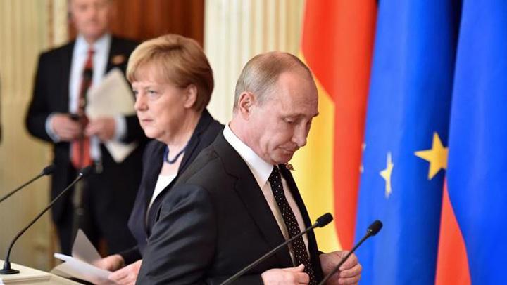 merkel putin Merkel: Nici acum nu a incetat focul! Putin: Dar situatia a devenit mai calma…