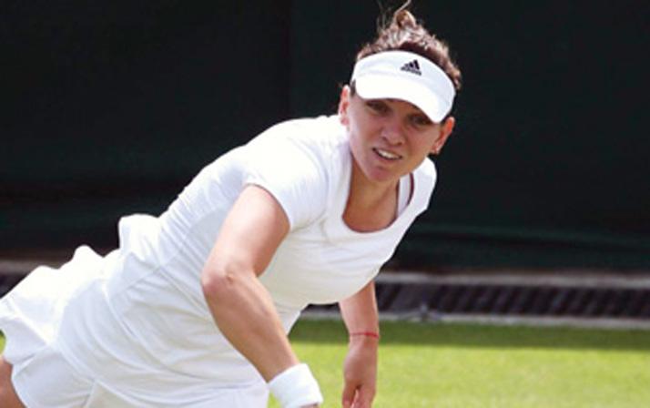 halep1 DEZASTRU LA WIMBLEDON! HALEP   ELIMINATA IN TURUL I DE O JUCATOARE DE PE LOCUL 106 WTA!