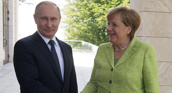 putin merkel Putin, luat la rost de Merkel pe tema homosexualilor