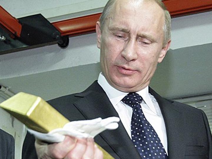 """Putin aur e1419582595118 Putin si a ajutat amicii sa stranga 24 de miliarde de dolari. """"Tarul"""" are 200 de miliarde"""