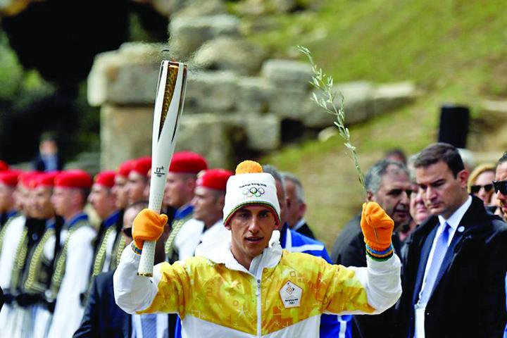 flacara1 Flacara olimpica si a inceput drumul spre Coreea de Sud