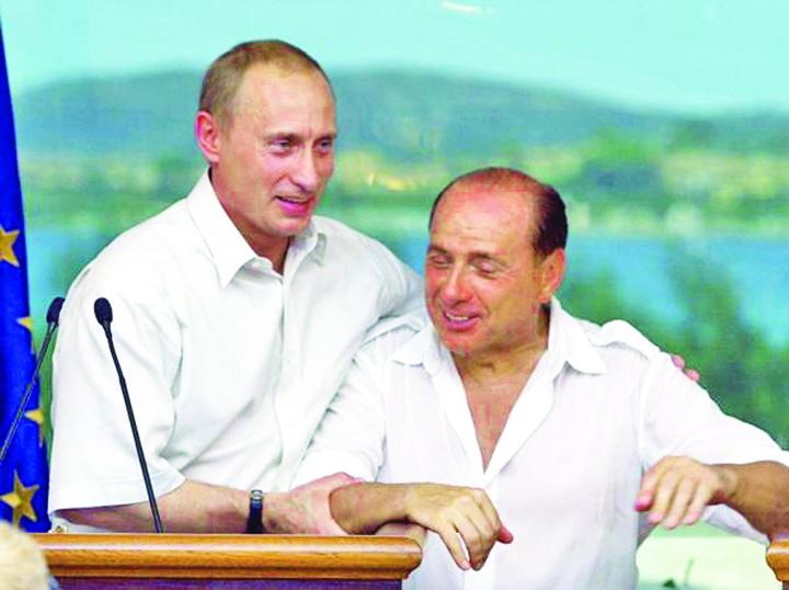 putin berlusconi Putin, în pat cu Berlusconi