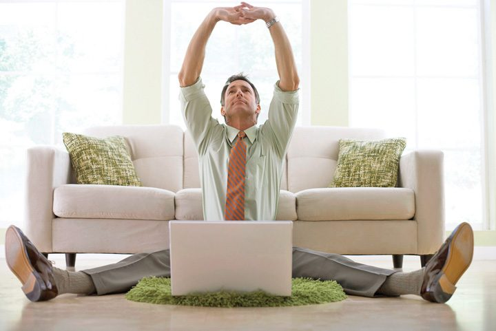 Man with laptop on floor 720x481 Munca de acasa a devenit legala