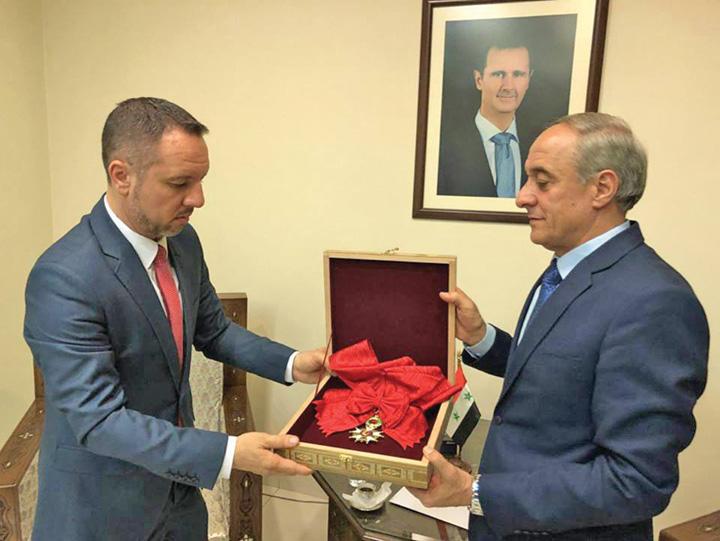 Bashar decoratiejpg Romania, implicata cu sila in conflictul sirian
