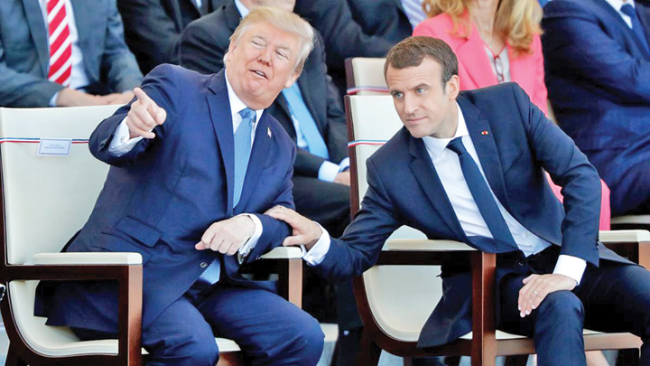 "French President Emmanuel Macron and US President Donald Trump attend the traditional Bastille Day military parade on the Champs Elysees in Paris Macron maraie la Trump: ""Razboi!"""