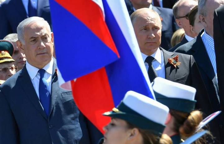 putin Putin, ocupat cu defilarea