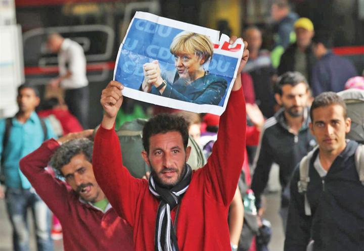 migranti Merkel vrea iar migranti, dar calificati