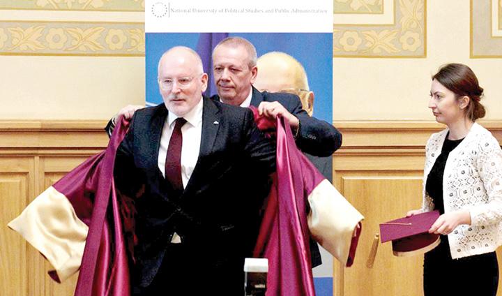 timm1 Un tablou de George Soros: Timmermans si slugarnicia romaneasca